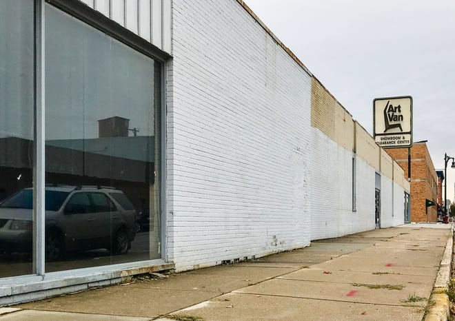 Developer Larry Jones plans to turn the former Art Van building in downtown Port Huron into the Wrigley Center, which will have three floors of lofts, food kiosks, a bakery, a rooftop patio and bar area, an artificial turf area and pet washing station and more.