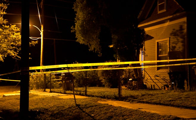 Police tape surrounds a house on the 100 block of Allen St. as authorities investigate the site as the location of a possible homicide Monday, Oct. 19, 2020.