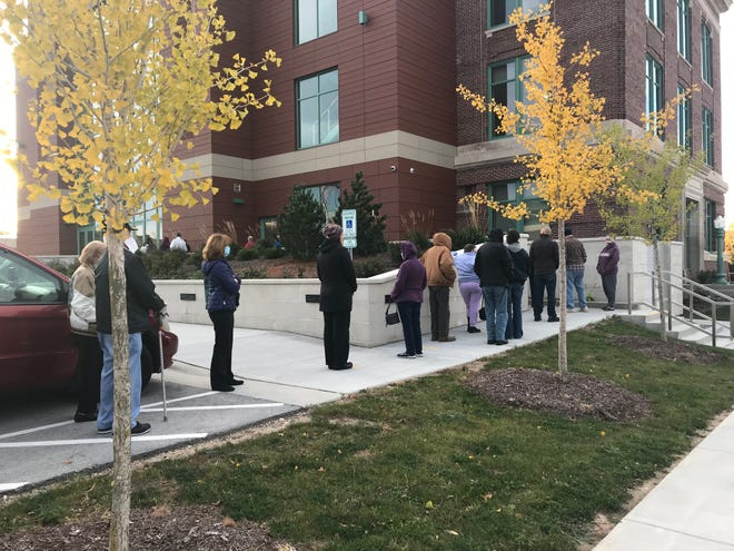 Voters stand in line at the start of early voting Tuesday, Oct. 20 at Sheboygan's City Hall.