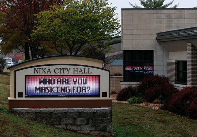 Opposition to Nixa's mask mandate, which ended April 30, 2021, has prompted a successful petition for a recall election against the town mayor. A display board outside Nixa City Hall promoted public masking on Oct. 20, 2020, a day before the mask mandate went into effect.