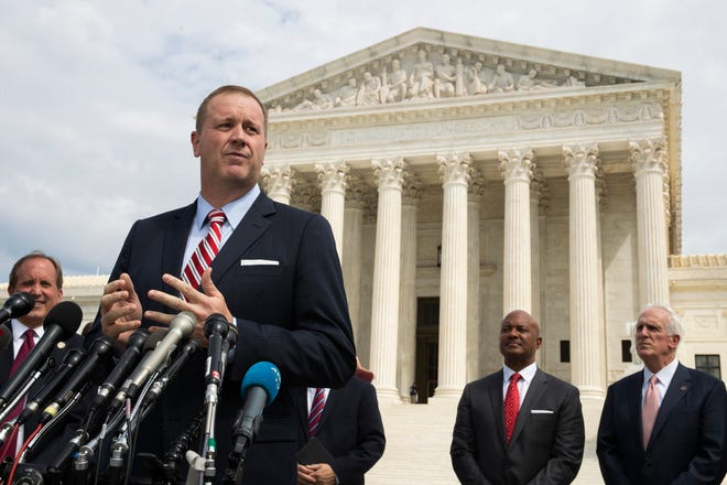 Missouri Attorney General Eric Schmitt speaks to reporters in front of the U.S. Supreme Court in 2019.