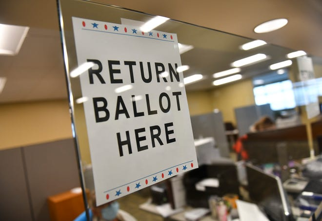 A sign marks the spot where voters can return ballots Tuesday, Oct. 20, 2020, at the Stearns County Service Center in Waite Park.