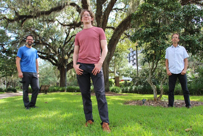Left to right, Tallahassee Symphony Orchestra conductor Darko Butorac, guest cellist Joshua Roman and TSO Principal Cellist Greg Sauer in the Chain of Parks.