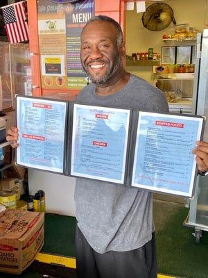 Dwyane Ash, owner of Oh' Lemonade, displays his menu.