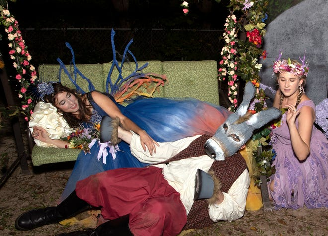 """Sleeping Titania (Laura Johnson) with Bottom (Mattie Ward) and First Fairy (Bianca Montague) in a scene from Southern Shakespeare's open-air production of """"A Mini Midsummer Night's Dream"""" set for Saturday, Oct. 24, in Thomasville, Georgia."""