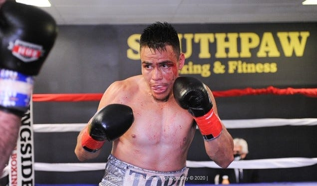 Rudy Ochoa eyes opponent Matt Doherty during their bout Saturday in New Hampshire.