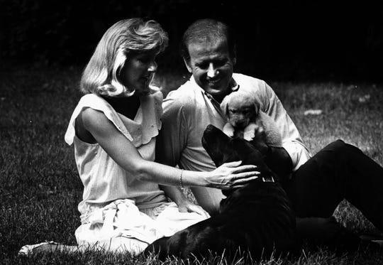 Jill Biden, left, and Joe Biden pet dogs August 3, 1986.