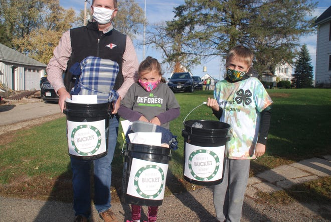 Ava and Kian Kelroy joined their dad Brian Kelroy in assembling the Buckets of Thanks for farmers on October 15. The care packages for area farmers included a variety of items, including cheese, sweets, gift cards and tie blankets made by the kids.