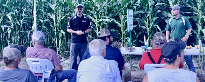 Hayden Henry, precision farming specialist with Swiderski Equipment, left, and Jordan Weiler, Sales agronomist at Cropping Central presented the core principals of our the trials.