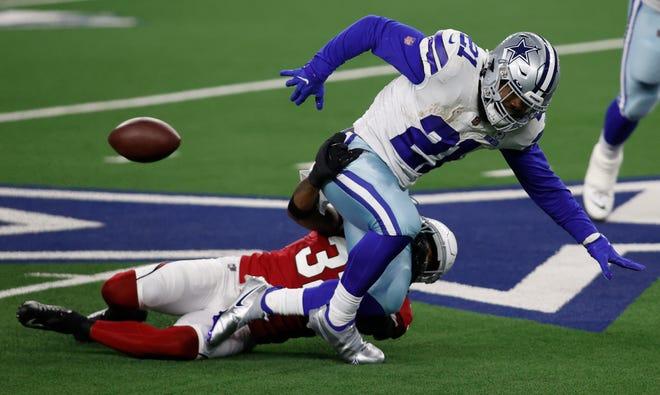 Arizona Cardinals strong safety Budda Baker causes Dallas Cowboys running back Ezekiel Elliott to fumble.