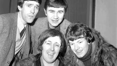 "FILE - In this Jan. 10, 1966 file photo, members of the band, the Spencer Davis Group, from top left: Muff Winwood, Pete York and Steve Winwood and Spencer Davis, foreground. British guitarist and bandleader Spencer Davis, whose eponymous rock group had 1960s hits including ""Gimme Some Lovin'"" and ""I'm a Man,"" has died at the age of 81. Davis' agent, Bob Birk, said Tuesday, Oct. 20, 2020 that he died in a hospital while being treated for pneumonia. (AP Photo, File) ORG XMIT: AMB115"