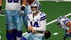 Dallas Cowboys quarterback Andy Dalton (14) gets up off the field after being sacked in the first half of an NFL football game against the Arizona Cardinals in Arlington, Texas, Monday, Oct. 19, 2020.