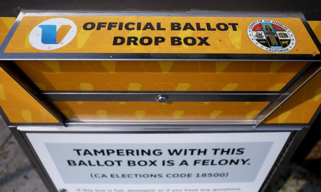 An official mail-in ballot drop box is posted outside of a library ahead of Election Day on Oct. 5, 2020, in Los Angeles, California. One of these boxes was set on fire in an incident officials are investigating as arson.