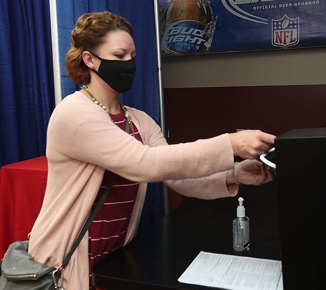 Sara Lenkowski of Barberton participates in mock voting Wednesday at Rocky's Gas in Barberton.