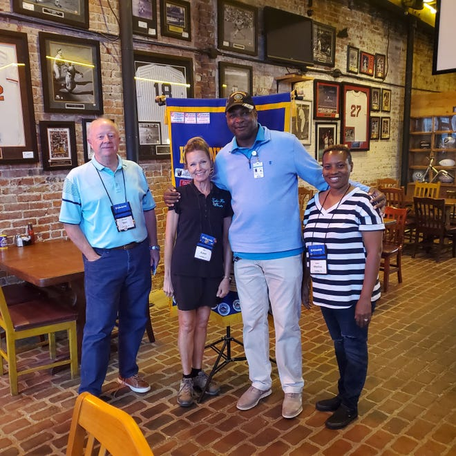Pictured are Kiwanis Club president Ron Marshall, Susan Ham, Sgt. Major Jones, and Monica Bolden.