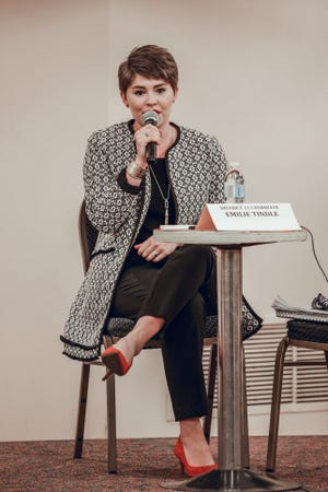 Emilie Tindle, Democratic candidate for State House District 11, talks about her views on education during a forum Tuesday night, Oct. 20.