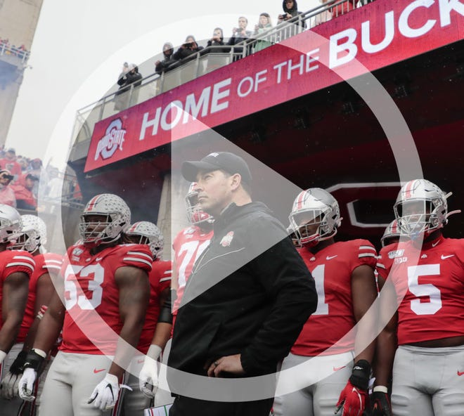 In this file photo, Ohio State Buckeyes head coach Ryan Day prepares to lead the Buckeyes onto the field before a NCAA Division I college football game between the Ohio State Buckeyes and the Wisconsin Badgers on Saturday, October 26, 2019 at Ohio Stadium in Columbus, Ohio.