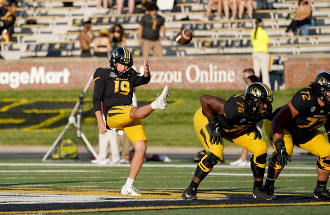 Missouri punter Grant McKinniss (19) warms up before a game against Alabama on Sept. 26 at Faurot Field.