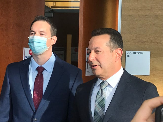 Defense attorney Jose Baez, right, stands beside his client, Dr. William Husel, as he speaks to reporters Wednesday outside a Franklin County Common Pleas courtroom.