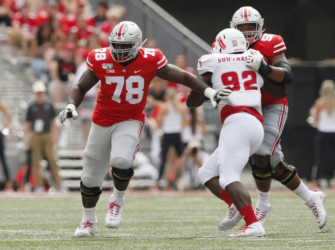 Ohio State tackle Nicholas Petit-Frere (78) feasted on his mother's cooking while he worked from home during the coronavirus lockdown, adding the necessary weight to become the Buckeyes' starter at right tackle.