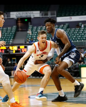 Bucknell guard Jimmy Sotos (3) tries to get past Rhode Island forward Cyril Langevine (10) during the second half of an NCAA college basketball game at the Diamond Head Classic, Saturday, Dec. 22, 2018, in Honolulu. (AP Photo/Marco Garcia)