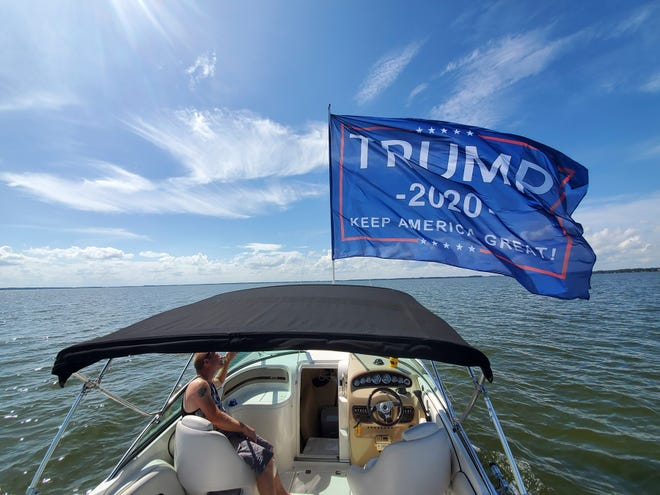 A trump flag flies high on a boat during the Trump Boat Parade in June. [Facebook]