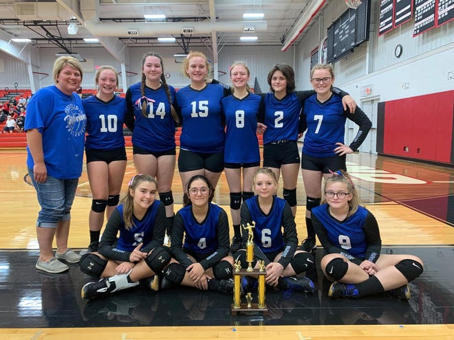 Buckeye Trail's 8th grade volleyball team proudly display their trophy after winning the Inter-Valley Conference 8th Grade South championship. Team members are seated left to right: Sydney Patterson, Grace Millhon, Liberty Taylor, Amanda Yoder standing left to right: Second row-Coach Devani Roe, Delanie Roe, Kayleigh Abrams, Emilee Crosby, Faith Betts, Brook Cole, Alonna Mathers