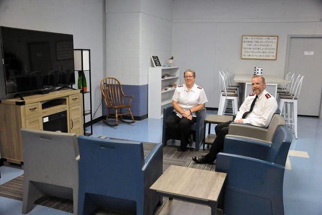 Majors Connie and Tim Higgins sit in Wooster Salvation Army's The Living Room, which opened Oct. 7. In the two weeks it has been open, 31 clients have been served.