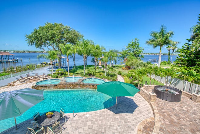 This supersized estate is an entertainer's dream, featuring a large pool, plus three spash pools, an in-deck spa, an outdoor kitchen and bar, two fire pits, a dock, with a boat lift, and mature landscaping, with fabulous views of the Intracoastal Waterway.