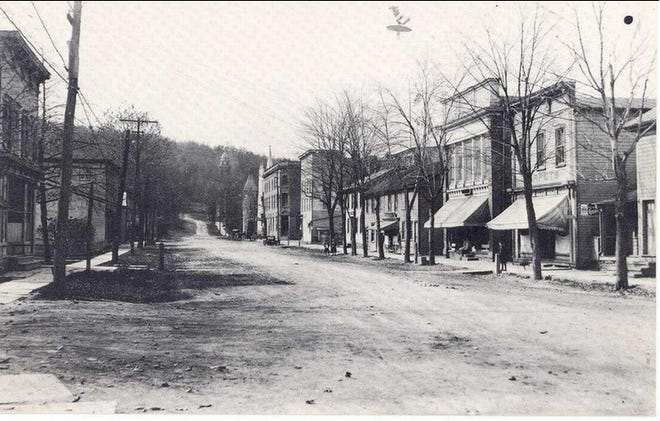 CHURCH STREET, HAWLEY – This is an early 1900's view showing Church Street, Hawley, Pa., looking from the corner with Penn Avenue west towards Main Avenue. Dr. Andrew S. Fritts is thought to have opened his private hospital in this section, probably in the storefront at left. Photograph  by Louis Hensel.