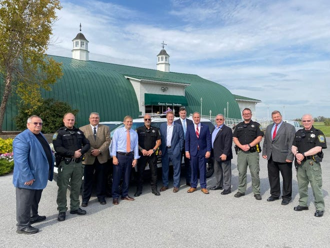 U.S. Congressmen John Joyce, Jim Jordan and Warren Davidson thanked local law enforcement officers for their service at Tuesday's rally at Green Grove Gardens.