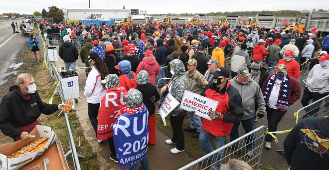 Thousands of supporters wait along West 12th Street to enter the rally held by President Donald Trump, Oct. 20, 2020, at the Erie International Airport in Millcreek Township.