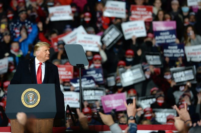 President Donald Trump speaks to supporters Oct. 20, 2020 on the tarmac at the Erie International Airport in Millcreek Township.
