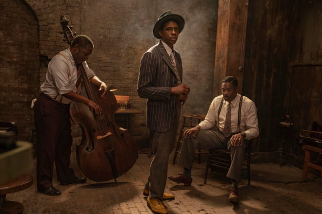 "Michael Potts, left; Chadwick Boseman, center; and Colman Domingo appear in ""Ma Rainey's Black Bottom."" Netflix previewed George C. Wolfe's August Wilson adaptation ""Ma Rainey's Black Bottom,"" showcasing Boseman's final performance."