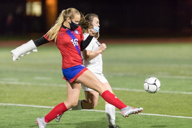 Hornell's Maddie Moore passes the ball forward under pressure from LeRoy Tuesday night.