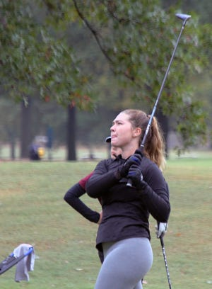 Truman junior Katelyn Bragg follows through on a shot in the second round of the Class 3 Missouri State High School Girls Golf Championips at Twin Hills Golf & Country Club in Joplin. Bragg finished in a tie for 14th to earn the first all-state honor for Truman since 2011.