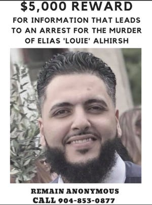 """The reward poster for information on the Feb. 26 shooting death of Elias """"Louie"""" Alhirsh in the parking lot of the Sugar Mill apartments at 3801 Crown Point Road."""
