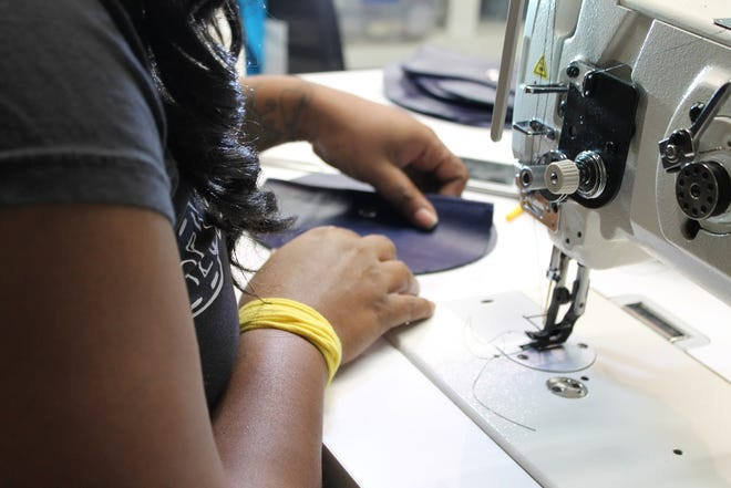 An employee works at Rethreaded, a Jacksonville nonprofit that hires human trafficking survivors and received a Women's Giving Alliance grant this year.