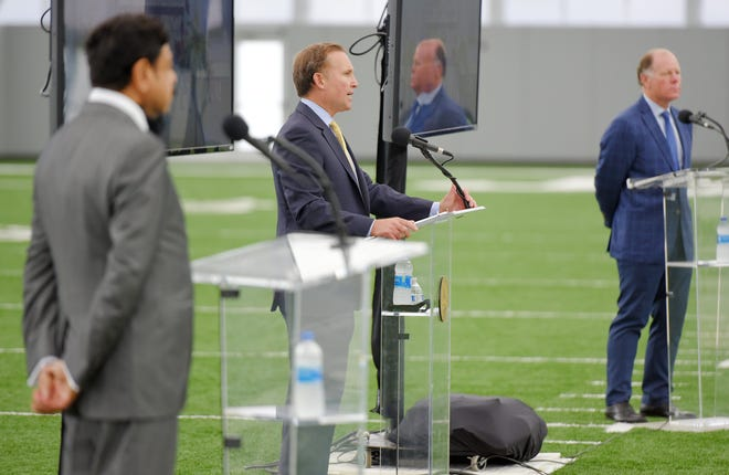 Jacksonville Mayor Lenny Curry flanked by along with Jacksonville Jaguars owner Shad Khan and President of the Jacksonville Jaguars, Mark Lamping during the announcement of the new plans for the proposed Lot J entertainment and residential development during a presentation inside the Jaguars Flex Field Monday, October 5, 2020.