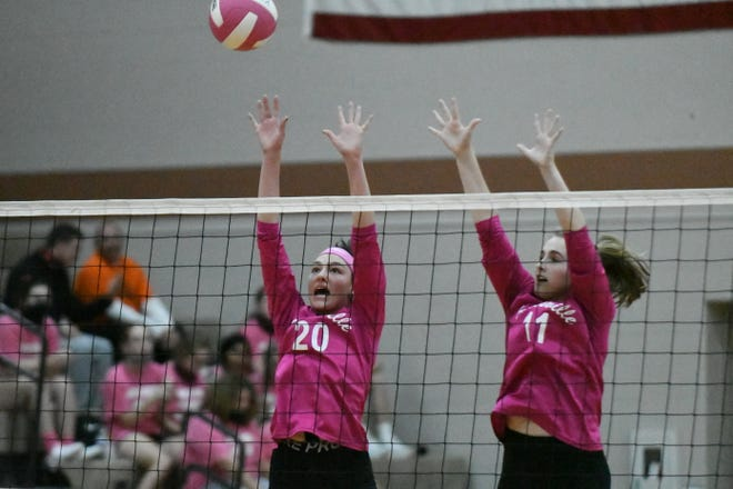 Kirksville's Emily Middleton, left, and Megan Pike, right, go up for a block during Tuesday's match against Hannibal.