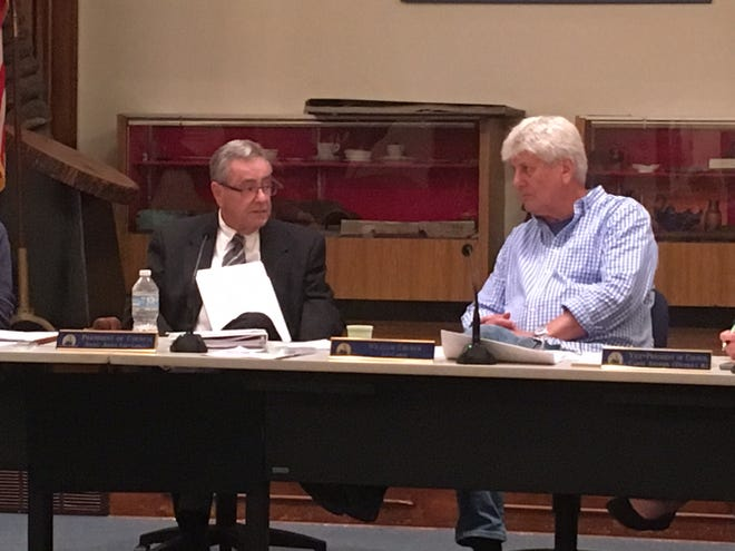Council President Jerry Jones, left, and Councilman Bill Church, both at-large, during a Village Council meeting. Jones, who has served on Village Council since 2006, recently announced his intent to resign at the end of 2020. There are 11 residents who have applied for Jones' post on council.