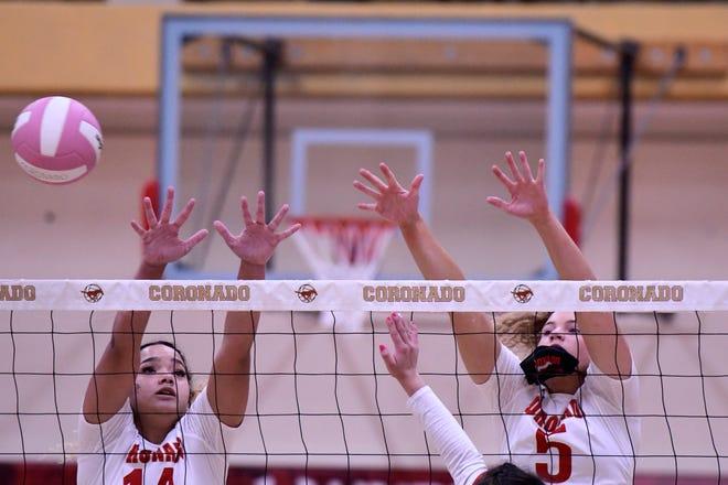 Coronado's Hailey King (14) and Caroline Willcoxon (5) blocks a ball from a Monterey attacker during a District 4-5A match Tuesday at Coronado High School.