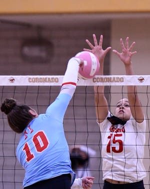 Monterey's Tatiana Trotter (10) hits the ball against Coronado's Kya Smith (15) during a District 4-5A match Tuesday at Coronado High School.