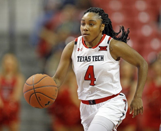 Texas Tech's Chrislyn Carr (4) dribbles the ball down the court during a nonconference game Nov. 9, 2018 against Jacksonville State at United Supermarkets Arena.