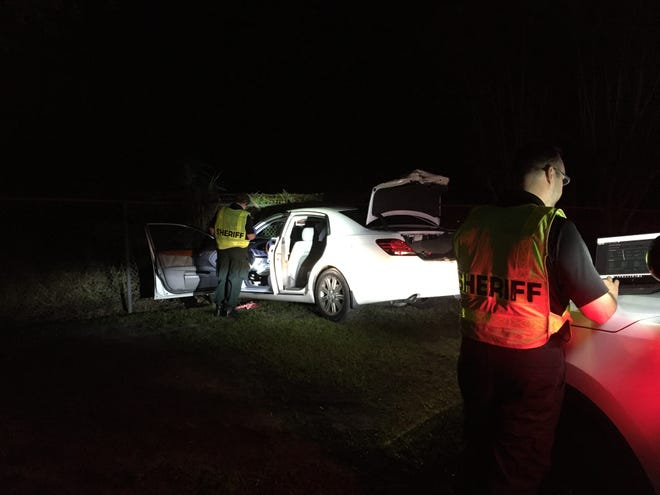 Polk County Sheriff's deputies investigate a fatal crash in Winter Haven on Tuesday night.