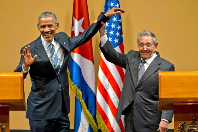 President Raul Castro, of Cuba, right, and President Barack Obama celebrate the end of their joint news conference in Havana in March 2016. Obama worked to normalize relations with Cuba, but his successor, Donald Trump, reversed his initiatives.