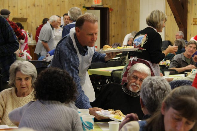 Community volunteers serve hundreds of free Thanksgiving meals each year in Mount Shasta. The tradition is more than 30 years old.
