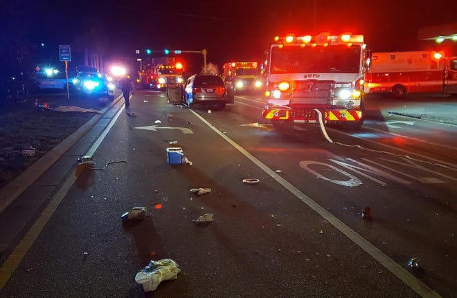 Firefighters and deputies repspond to a fatal wreck at the corner of U.S. Highwy 331 and U.S. Highway 98 on Tuesday night. Another wreck happened nearby on Highway 98 in the same time period.