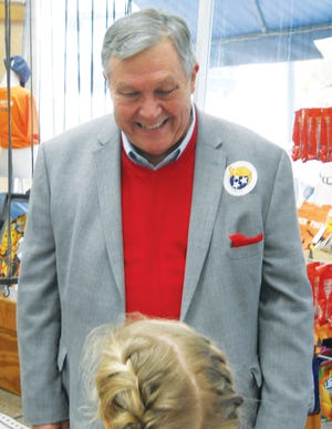 CHATTING AT HOSKINS — State Rep. John Ragan, R-Oak Ridge, listens to state Rep. Cameron Sexton's daughter Greer Sexton at Hoskins Drugstore Tuesday morning in Clinton. The stop at Hoskins by Ragan and other legislators is part of the Republican Road to Victory Tour.
