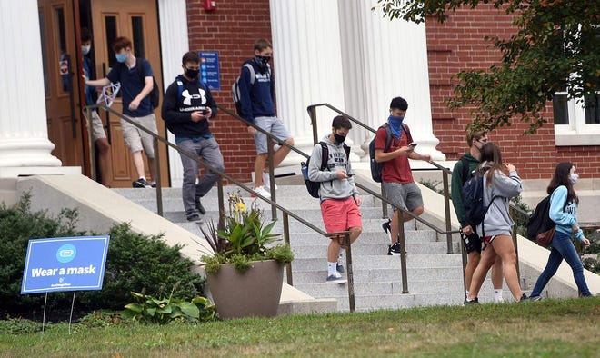 University of New Hampshire students exit Hamilton Smith Hall in Durham in September 2020.